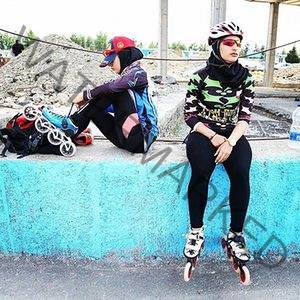 Women getting ready to roller skate at Azadi Sports Complex, Tehran, Iran.
