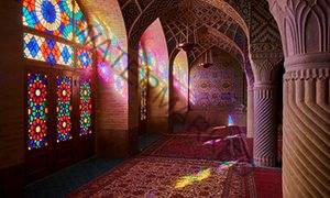 Light floods in through stained glass windows at Nasir-al-Molk mosque, Shiraz, Iran.