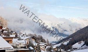 Rooftops and misty, snowy mountains at St Anton am Arlberg