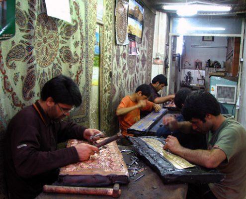 A group of craftsmen working in a metalworking workshop in Esfehan